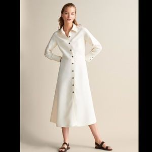 Shirt dress with long sleeves and buttons. NWT